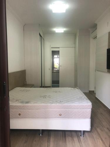 Cama ou camas em um quarto em Reserva Enseada