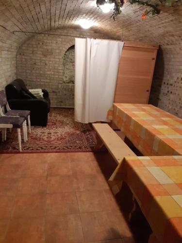 A seating area at Mónika Vendégház