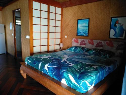 Cama ou camas em um quarto em Tehuarupe Surf Studios