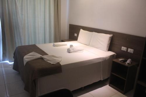 Cama ou camas em um quarto em Pousada Sky Beach Flat