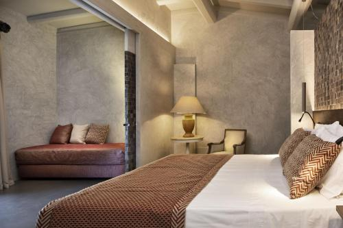 A bed or beds in a room at Stazzo Lu Ciaccaru