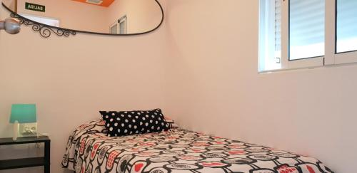 A bed or beds in a room at Arc House San Lorenzo