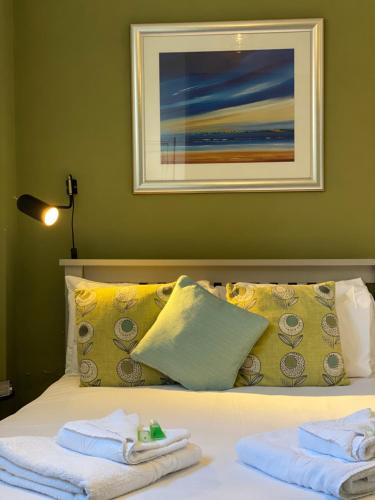 A bed or beds in a room at The Elizabeth House Hotel
