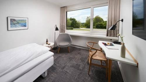 En eller flere senge i et værelse på Trinity Hotel & Konference Center