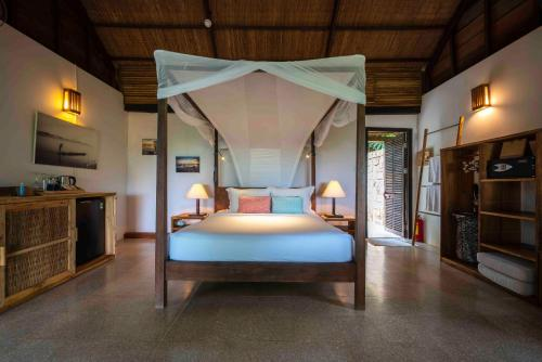 A bed or beds in a room at Mango Bay Resort