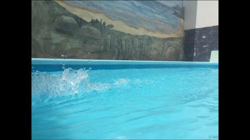 The swimming pool at or near Hotel Palmeiras