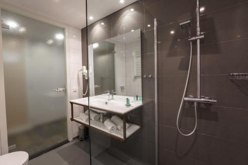 Een badkamer bij Hotel Zeezicht
