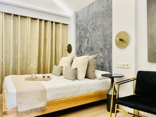 A bed or beds in a room at The Secret Suites