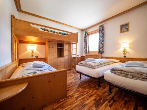 Postel nebo postele na pokoji v ubytování Bait da Salient MyHoliday Livigno