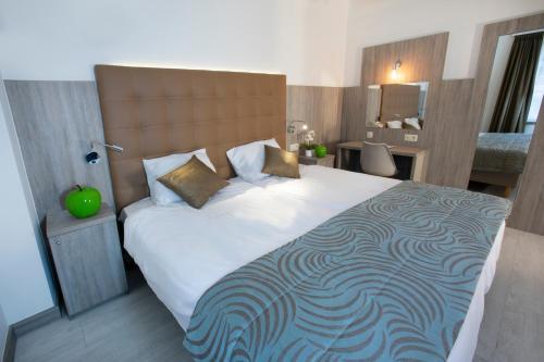 Un ou plusieurs lits dans un hébergement de l'établissement Hotel Atlanta Knokke
