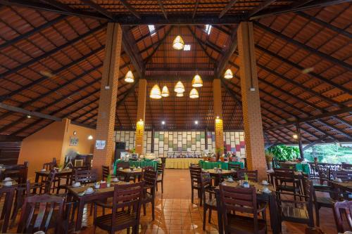 A restaurant or other place to eat at Phi Phi Natural Resort-SHA Plus