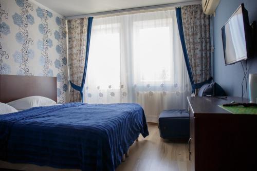 Кровать или кровати в номере Golubaya Bukhta