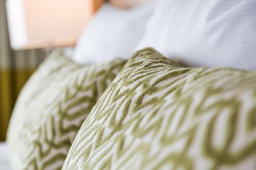 Ein Bett oder Betten in einem Zimmer der Unterkunft Van der Valk Airporthotel Düsseldorf