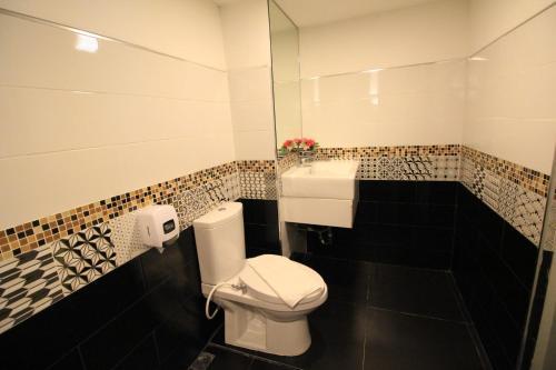 A bathroom at V Wish Hotel