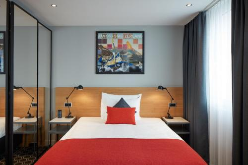 A bed or beds in a room at Hard Rock Hotel Davos