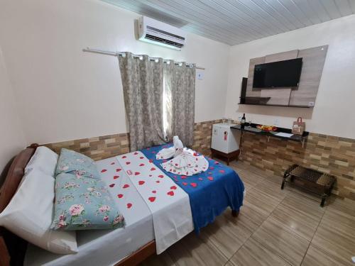 Cama ou camas em um quarto em Hotel Marajó - Turismo de Experiência