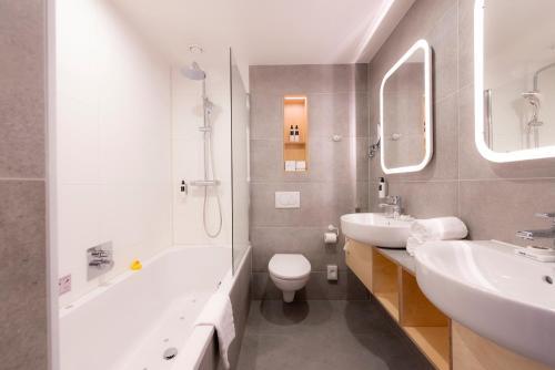 A bathroom at WestCord Hotel Delft