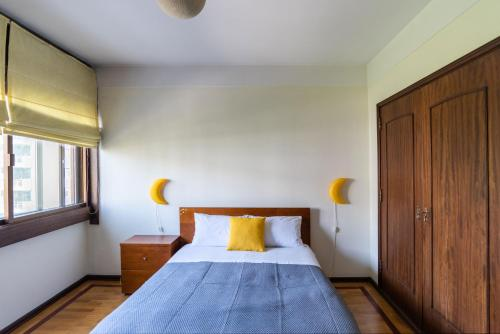 A bed or beds in a room at Porto Family Home by MP