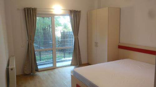 A bed or beds in a room at CheckInn Apartment