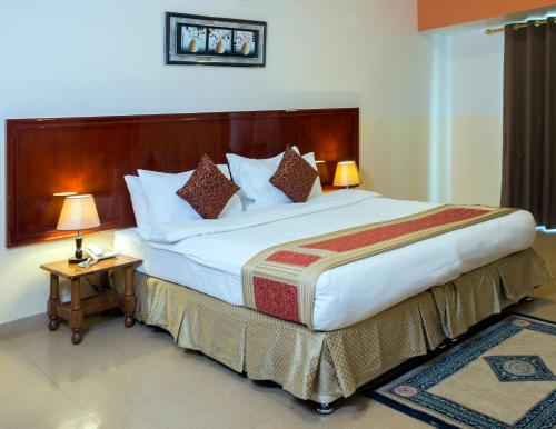 A bed or beds in a room at Safeer Plaza Hotel