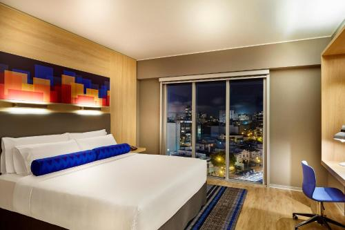 A bed or beds in a room at Aloft Lima Miraflores, a Marriott Hotel