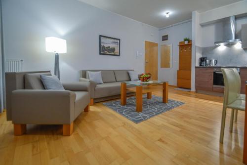 Część wypoczynkowa w obiekcie Apartamenty Na Wyspie - Casa Marina