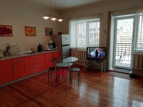 Телевизор и/или развлекательный центр в Lodge Shishma