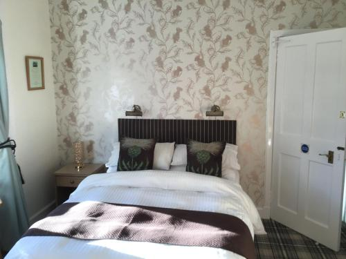 A bed or beds in a room at Woodvale
