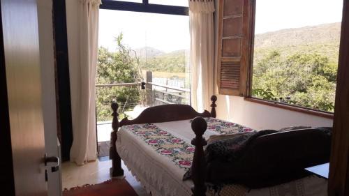 Cama ou camas em um quarto em Casas da Paty