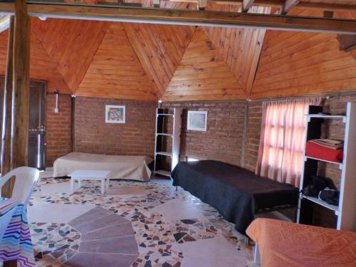 Una cama o camas en una habitación de Cabaña Taski Wasi