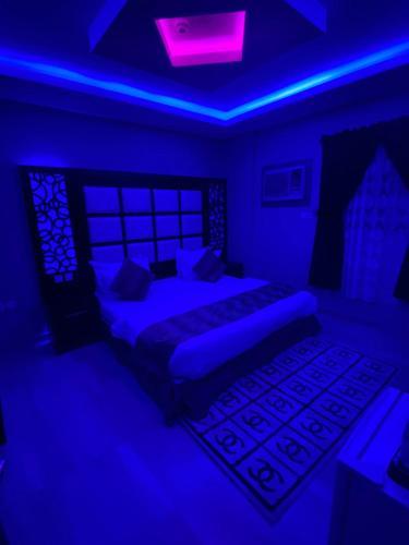 Cama ou camas em um quarto em الاتحاد الذهبية للوحدات السكنية