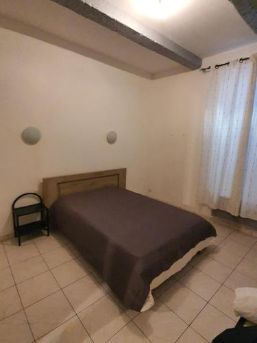 A bed or beds in a room at 38 rue Curiol MARSEILLE