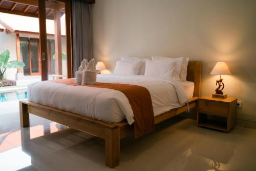 A bed or beds in a room at The Ume