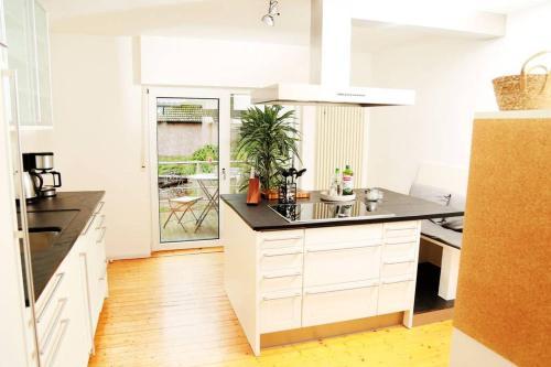 A kitchen or kitchenette at Wunderschönes Haus im Herzen d. Nationalpark Eifel
