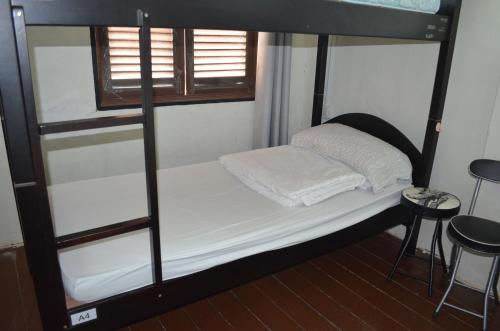 A bunk bed or bunk beds in a room at Dou Houz Guest House