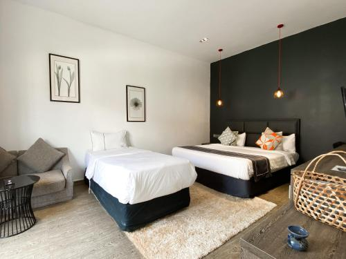A bed or beds in a room at White Boutique Hotel and Residences