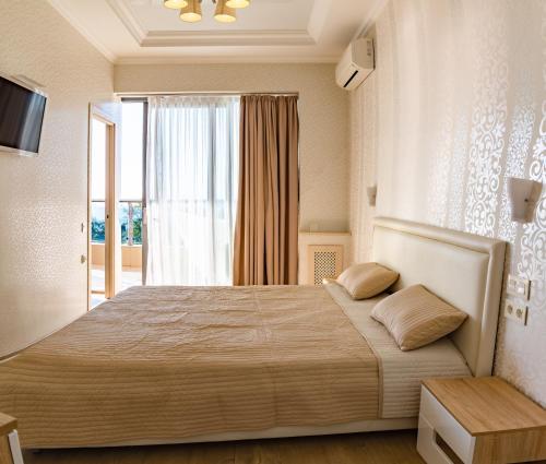 Кровать или кровати в номере Apartment Ideal House