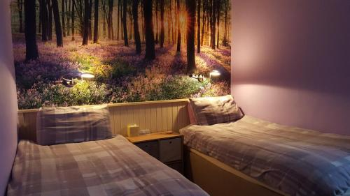A bed or beds in a room at Bed & Breakfast - The Green Cruachan