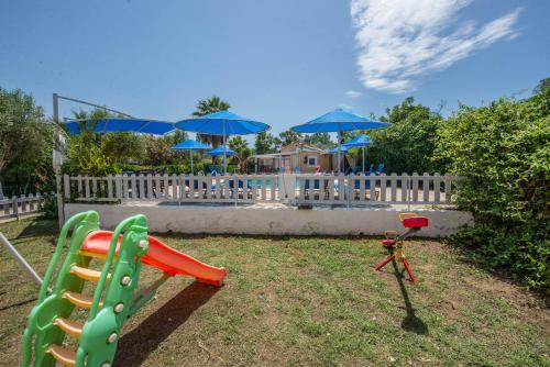 Children's play area at Eleni Family Apartments