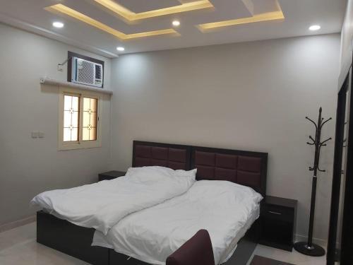 Cama ou camas em um quarto em شقق عمار - شقق خاصة