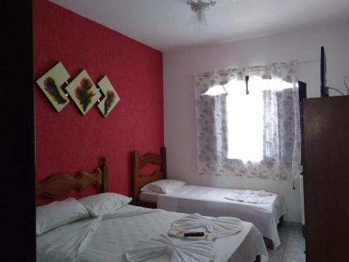 A bed or beds in a room at San Marino Hotel
