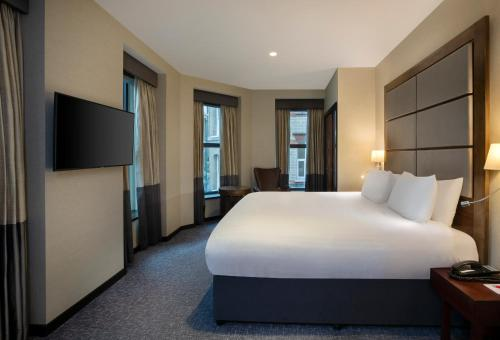 A bed or beds in a room at Leonardo Royal London St Paul's