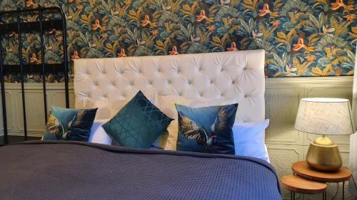 A bed or beds in a room at Pension Da Gigi