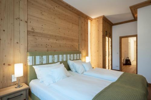 Ein Bett oder Betten in einem Zimmer der Unterkunft Romantik Hotel Klostergut Jakobsberg