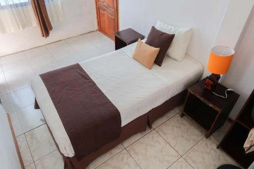 Cama o camas de una habitación en Maytenus Galapagos