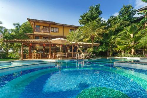 A piscina localizada em Hotel Via dos Corais ou nos arredores