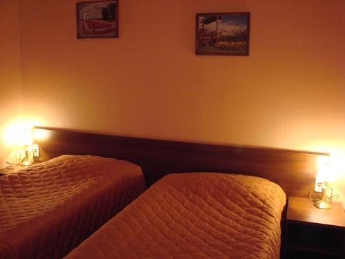 Кровать или кровати в номере Парк Отель