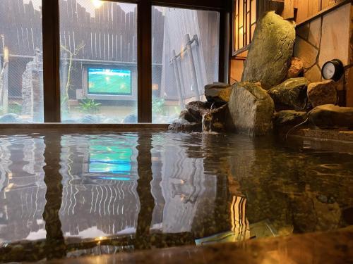 The swimming pool at or near Dormy Inn Akihabara