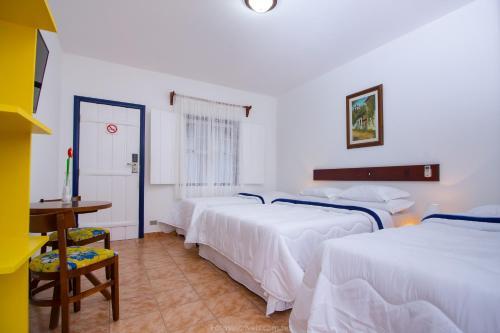 Cama ou camas em um quarto em Pousada Aconchego