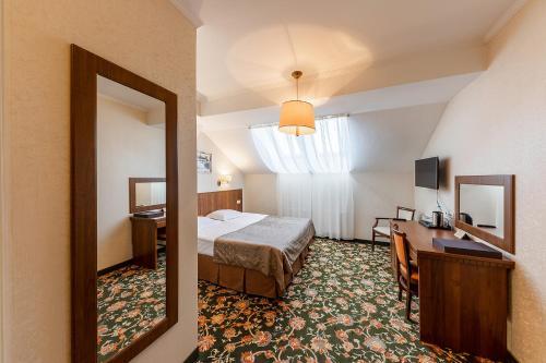 Кровать или кровати в номере Двор Подзноева - Бизнес Корпус